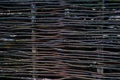 Wicker element of the fence. Ecological natural background stock photo