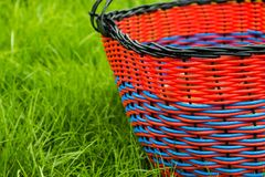 Wicker empty basket for products on grass stock image