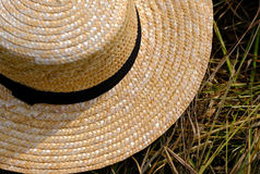 Wicker farmer hat. Good quality close up photo of a classic broad-brimmed hat view from above: you may see classic farmer hat with dark almost black wide fabric royalty free stock images