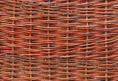 Wicker a fence. Fragment wicker a fence, the sample of handmade from vegetative raw material Stock Photography