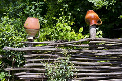 Wicker fence with clay jugs Royalty Free Stock Image