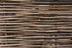 Wicker fence in the countryside. Background of the fence of twigs stock images