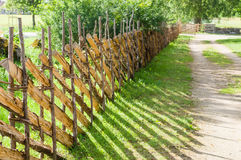 Wicker fence or lath near country road Stock Photography