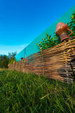 Wicker fence in nature. Royalty Free Stock Photos