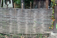 Wicker fencing with high road Stock Photos