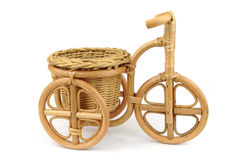 Wicker a flowerpot. In the form of a bicycle on a white background Stock Image