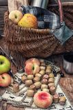 Picnic set mix. Wicker fruit basket,blanket for picnic.Photo tinted.Selective focus Stock Photo