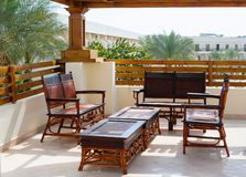 Wicker furniture on the balcony Stock Photo