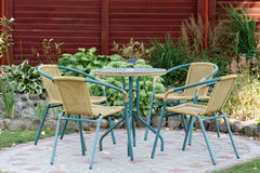 Wicker furniture in the garden Stock Images