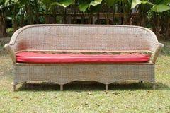 Wicker Furniture Garden bench on grass Royalty Free Stock Photos