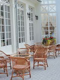 Wicker furniture near white house wall Stock Photography