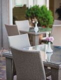 Wicker furniture in the restaurant Stock Photos