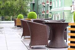 Wicker furniture in summer cafe on cinema terrace Stock Photos