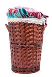 Wicker hamper. Full of dirty clothes over white background stock photography