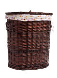 Wicker hamper. Full of dirty clothes over white background royalty free stock photos