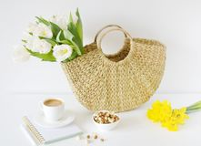 Wicker Handbag with Flowers Tulips, Spring Time, Summer Concept. White Background, Copy Space stock photo