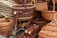 Wicker handicraft. Wicker baskets and toys choice. Beautiful handicraft at a market in Poland Stock Images