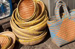 Wicker Handicraft. A traditional wicker bowl basket and bags in a handicraft market Stock Photos