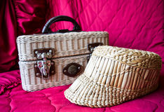 Wicker hat and bag. Wicker hat and a bag for travel Royalty Free Stock Photo