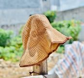 Wicker hat on the fence. Brown wicker hat on the fence Stock Images