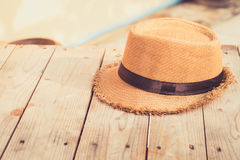 Wicker hat with sun light Royalty Free Stock Photo