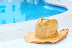 Wicker hat with swimming pool Stock Photo
