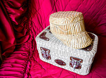 Wicker hat and a trunk. Wicker hat and a wicker trunk Royalty Free Stock Image
