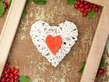 Wicker heart and berries Stock Photo