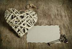 Wicker heart handmade with the key Royalty Free Stock Photo