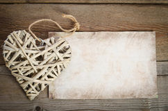 Wicker heart handmade with a sheet of paper for you text Royalty Free Stock Image