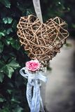Wicker heart and pink rose royalty free stock photo
