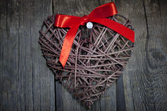 Wicker heart on wooden boards Royalty Free Stock Photo