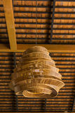 Wicker lamp on ceiling Royalty Free Stock Images
