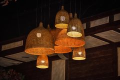 Wicker lamps on the ceiling, decorative lamps royalty free stock photos