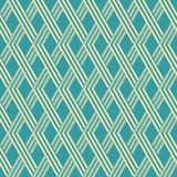 Wicker lattice seamless geometric blue and yellow pattern. Abstract seamless geometric pattern in blue and yellow colors. Wicker lattice of intersecting stripes Royalty Free Stock Images