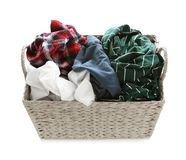 Wicker laundry basket full of dirty clothes on white. Background stock photo