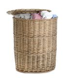Wicker laundry basket full of dirty clothes on white. Background royalty free stock image