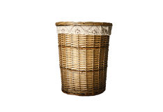 Wicker laundry flasket. Laundry flask made of vines woven with a cover and a cloth bag. Isolated on white Royalty Free Stock Photo