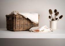 Wicker Linen basket on a shelf Stock Photo