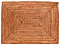 Wicker Mat. A Woven Wicker Placemat hand crafted in Indonesia royalty free stock photos