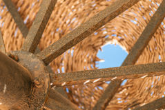 Wicker metal vintage umbrella on a background of blue sky, fragment Stock Image