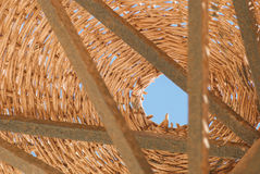 Wicker metal vintage umbrella on a background of blue sky, fragment Stock Photos