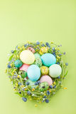 Wicker nest with easter eggs Royalty Free Stock Photography