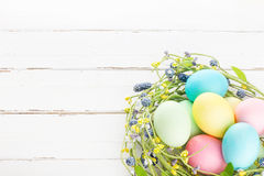 Wicker nest with easter eggs Royalty Free Stock Images