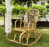 Wicker old wooden rocking chair Stock Photos