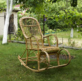 Wicker old wooden rocking chair Royalty Free Stock Image