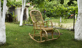 Wicker old wooden rocking chair Royalty Free Stock Photo