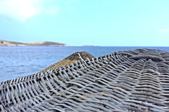 Wicker parasols and sea view Royalty Free Stock Photo