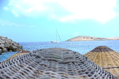 Wicker parasols and sea view Stock Images