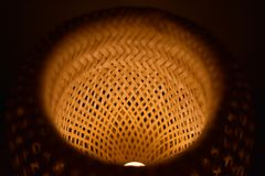 Wicker pattern lampshade lamp stock image
